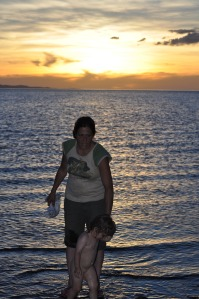 Nicky and baby lily, sunset in lake turkana
