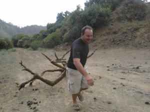 Simien mountain bush camp, nic dragging a tree for the fire